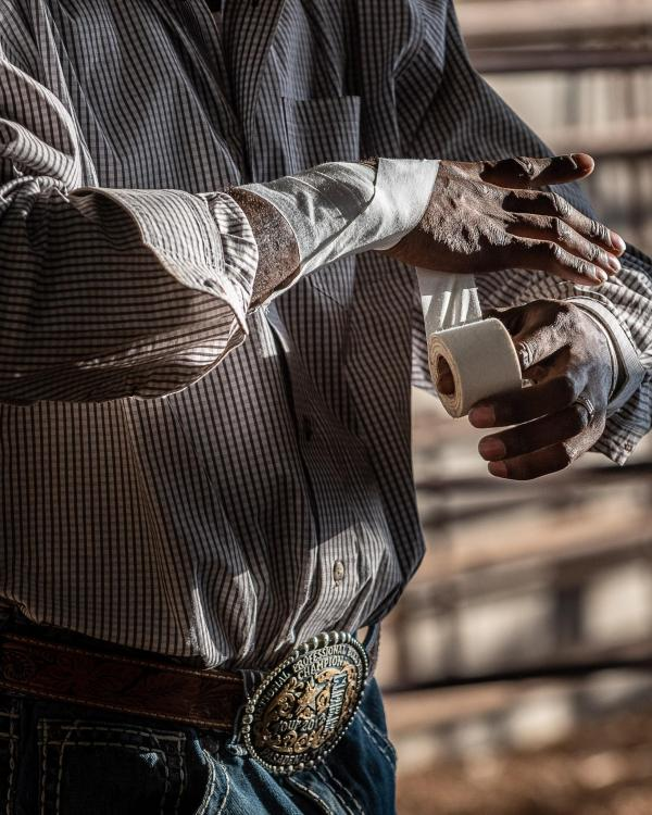 """""""Getting Taped,"""" the First Place winner in the Texas Photographic Society Members Exhibition Show, was taken during the Bailey's Riding On A Dream bull riding competition at Dripping Springs Ranch Park."""