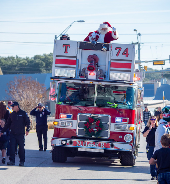 """Santa arrives at """"Christmas on Mercer"""" with some help from North Hays County Fire Rescue, Saturday, December 7th, 2019. Photo by Dave Wilson"""