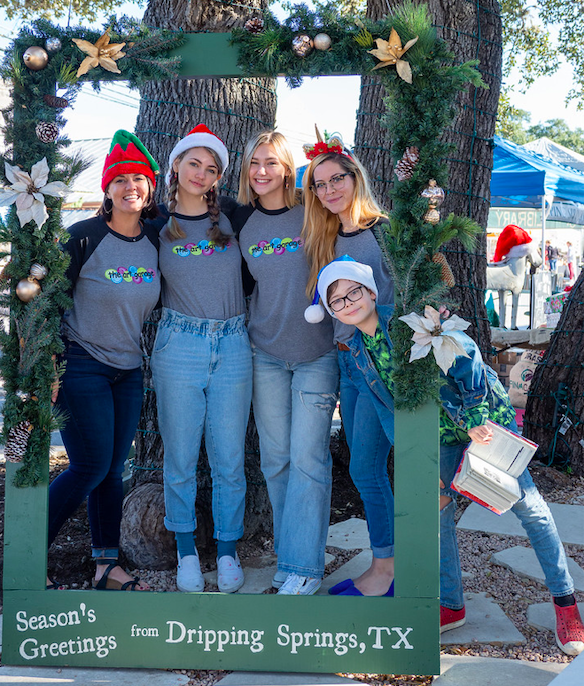 """Staff from The Art Garage send Season's Greetings during """"Christmas on Mercer"""", Saturday, December 7th, 2019. Photo by Dave Wilson"""