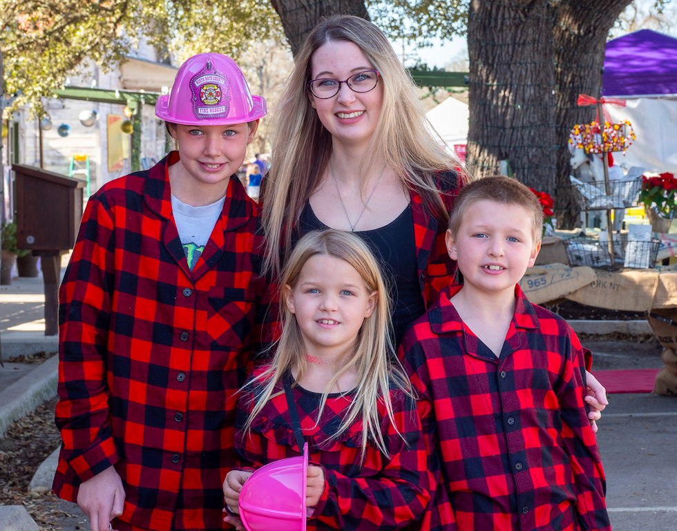 Melissa, Kelly, Persephone and Joshua Otterline coordinated beautifully at Christmas on Mercer in Dripping Springs, Saturday, December 7th, 2019. Photo by Dave Wilson.