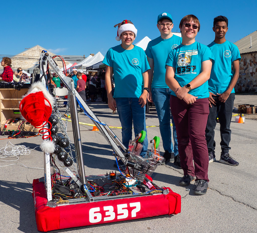 """Members of The Spring Konstant robotics team demonstrate their robot, """"Torsion"""", during Christmas on Mercer in Dripping Springs, Saturday, December 7th, 2019. Photo by Dave Wilson."""