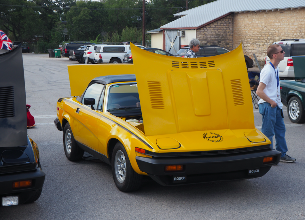 A TR7. Yellow is considered the classic color for th TR7.
