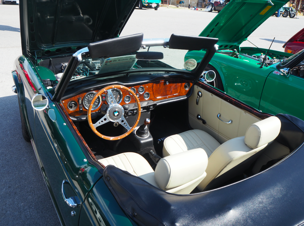 A perfectly restored interior of a TR6. Part of the emotional response of driving these cars comes from the cockpit smell of leather, wood, and the engine. You're not removed from the driving experience in a plastic shell.