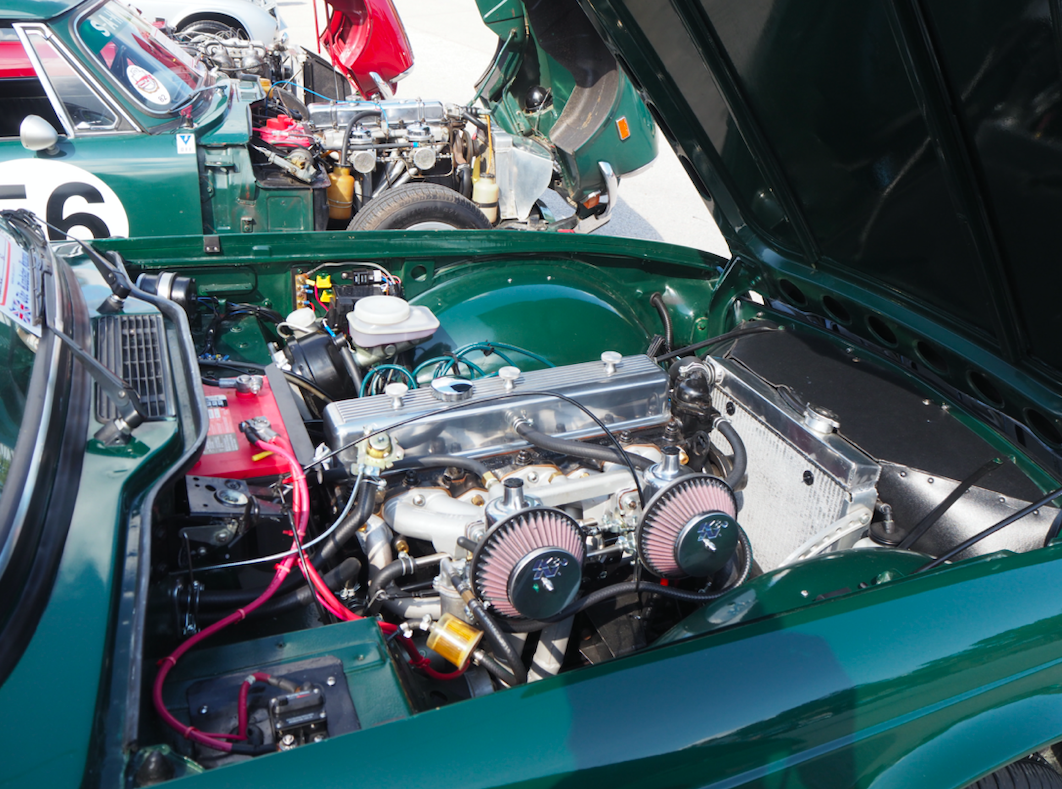 An in-line six cylinder engine and growling dual carburetors belonging to a TR6. Each year the convention honors one specific car, and this year it was the TR6.