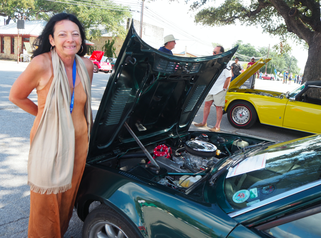 "Convention car judge Melody Laurel, from Bucks County PA, shows off the new engine in her TR8. The newly built modified engine brings the car's horsepower to an impressive 300. ""It's basically a muscle car, Laurel said. ""When I drive it back home the engine will have approximately 4,000 miles on it."