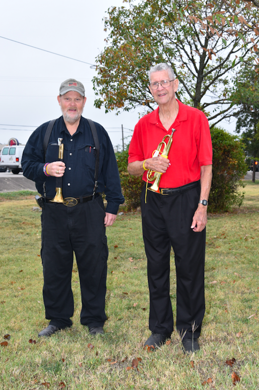 Darrell Anglin and Bill Cox played echo-taps during the lowering of the flag.