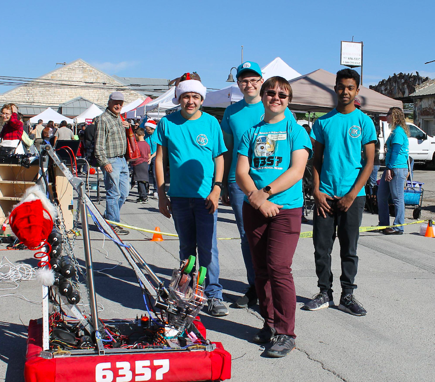 "Members of The Spring Konstant robotics team demonstrate their robot, ""Torsion"", during Christmas on Mercer in Dripping Springs, Saturday, December 7th, 2019. Photo by Haley Henry."