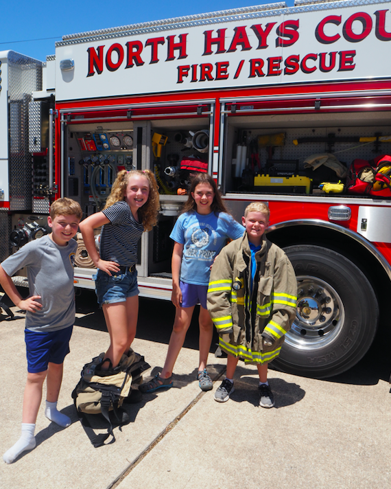 Local children Joey, Abby, Morgan and William had fun learning about firefighting equipment.