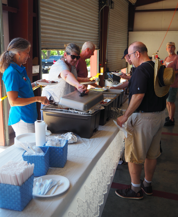 Dripping Springs Cook-Off members not only donated and cooked the BBQ, they also manned the chow line. Forefront DSCO member Michele Ryon works the serving line.