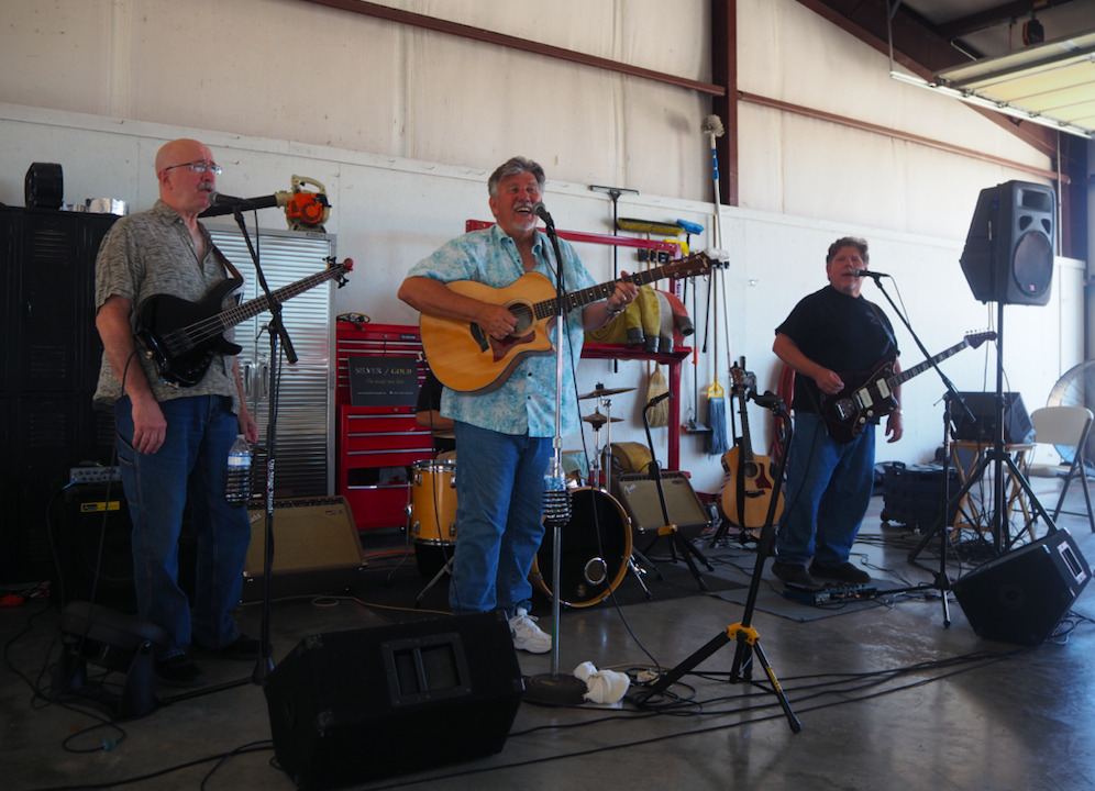 """Local musical group """"Silver and Gold,"""" donated their talent to the event. (From left to right) Jeff King (bass), Mark Dotson (guitar), Randall Maxwell (drums), and Frank Iarossi (guitar)."""