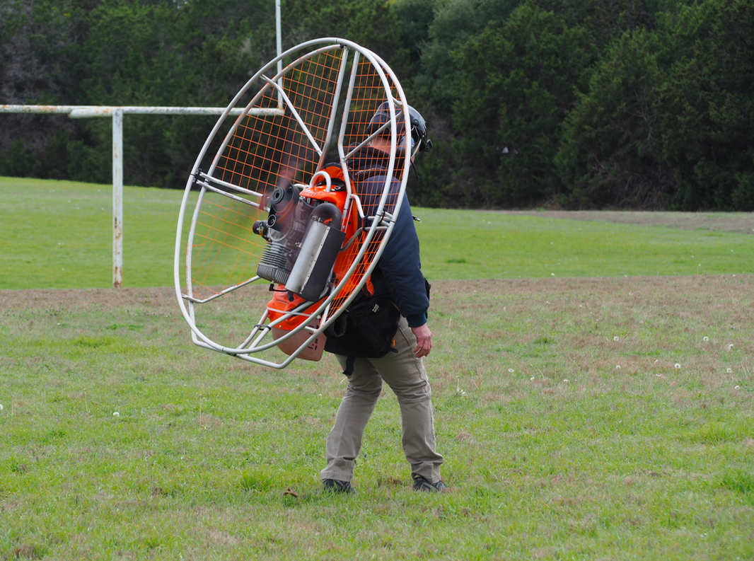 With the engine fan on, Reynold cautiously walks towards his paraglider assembly, which he had previously already laid out.