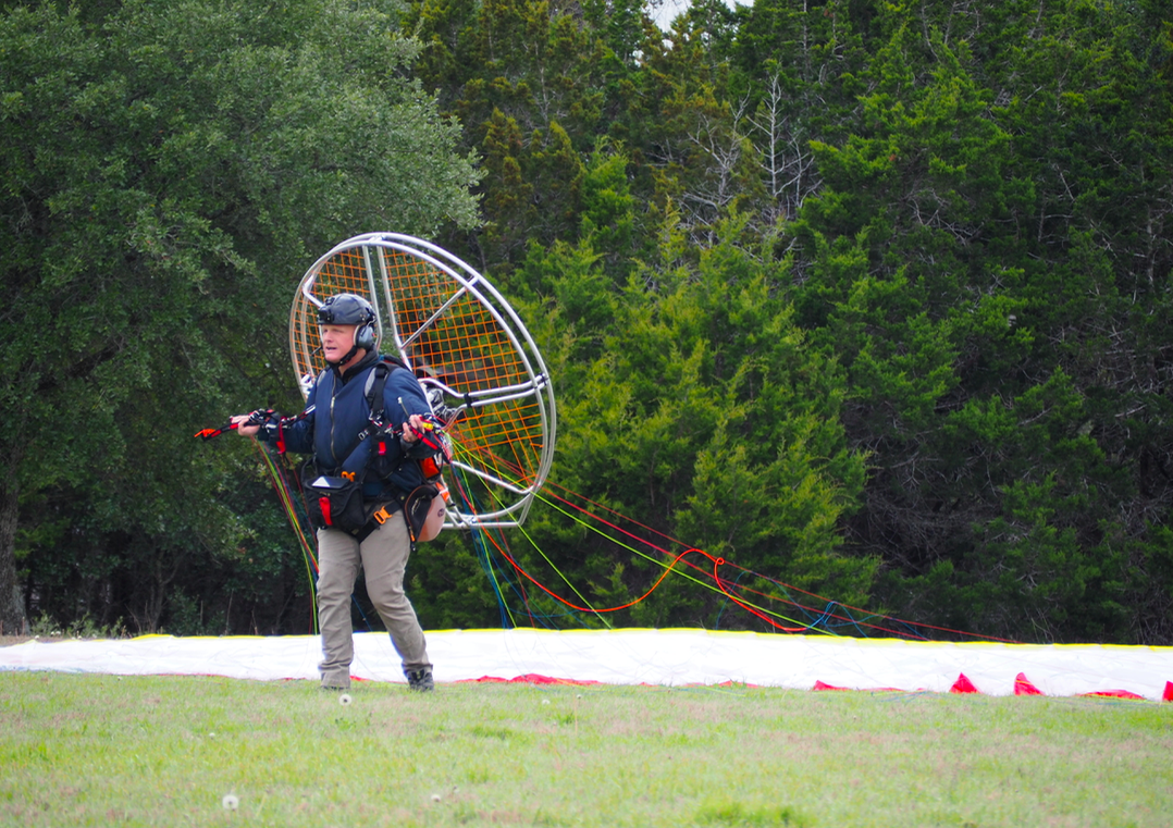 Gauging the wind one last time, Reynold prepares to create lift for his Paraglider.