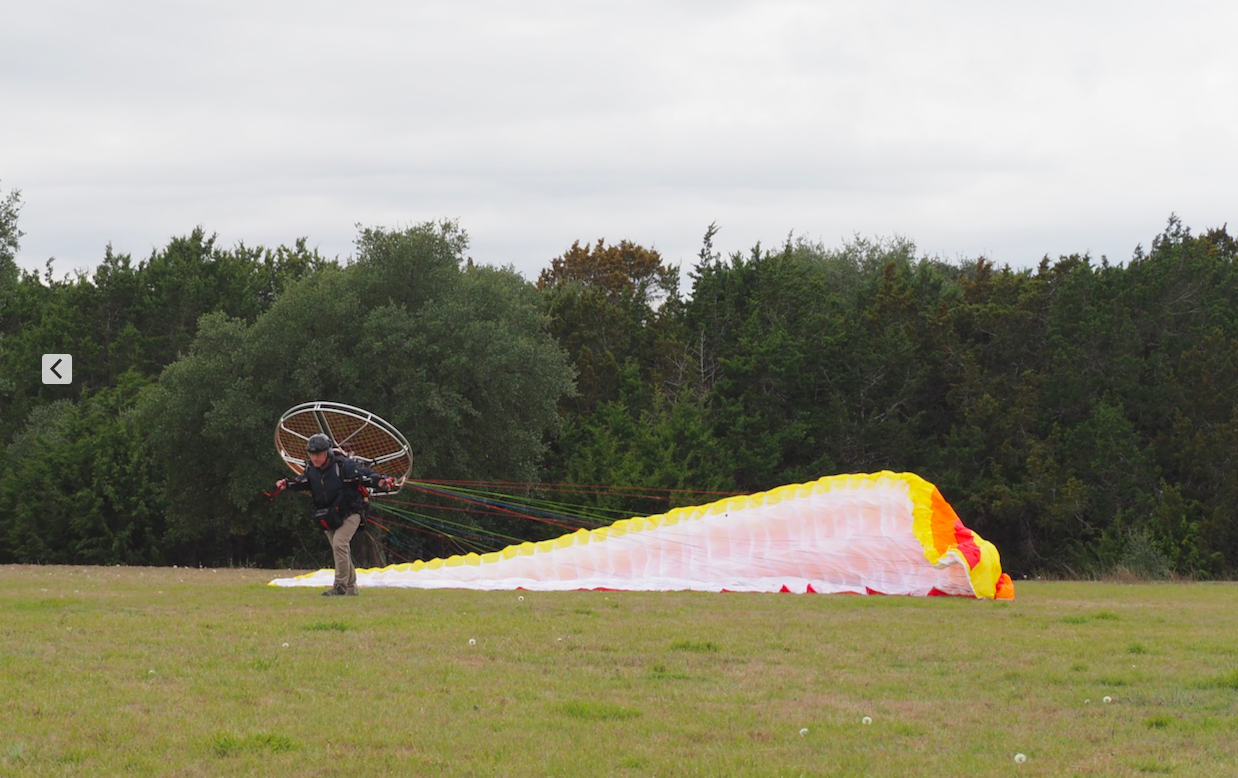 Air begins to lift his Paraglider.