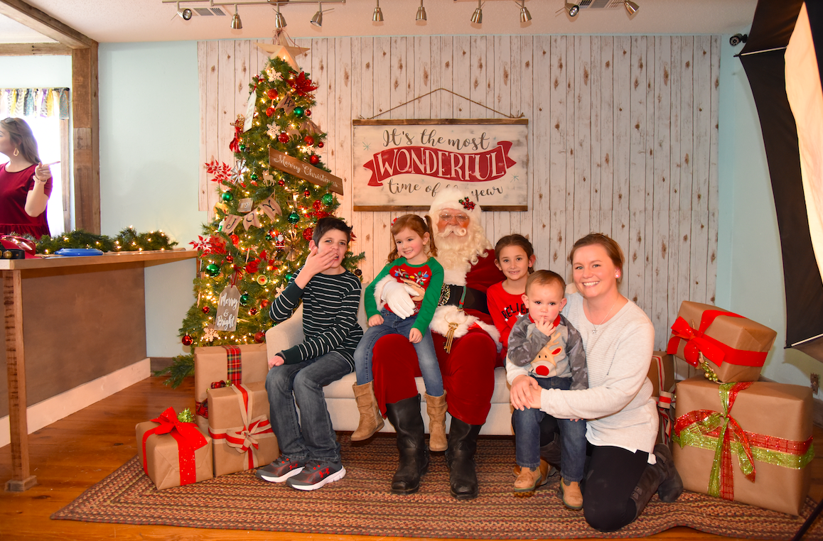 The Willis family stopped by to visit with Santa at the Rotary event. From left to right: Brenden, Makynden, Santa, Kingsley, Grayson, and Stephanie (mom).