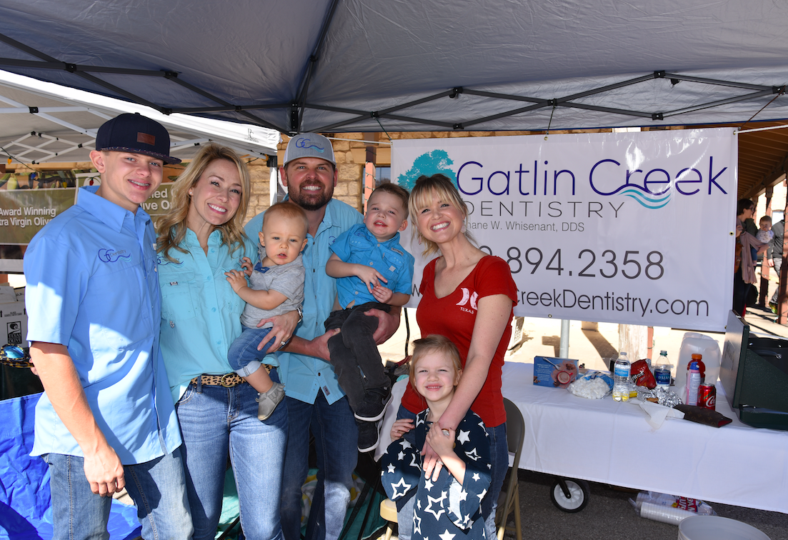 Dr. Shane Whisenant and family greeted people at their booth. From left to right: Chase Whisenant, Janey Whisenant, Ledger Whisenant, Dr. Whisenant, Beckham Whisenant, Lindsay Wallace, and Haidyn Wallace.