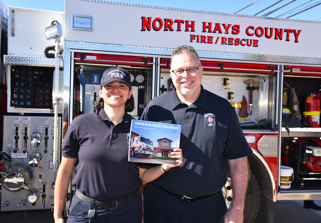 North Hays County Fire Rescue firefighters Cindy Lott and Lieutenant Rudolph were on hand to autograph North Hays Firefighters Calendars.