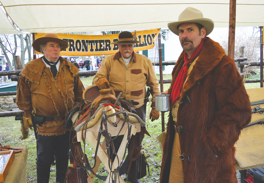 "Bill Patterson, Tom Whiteside, and Jeff Cantrell of ""Legends of the Texas Rangers"" were on hand with historic weapons."