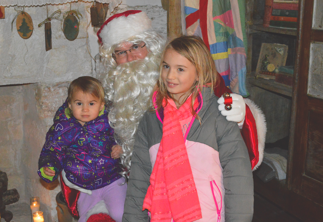 Santa was taking wish lists from Evangeline and Samantha Sellers.