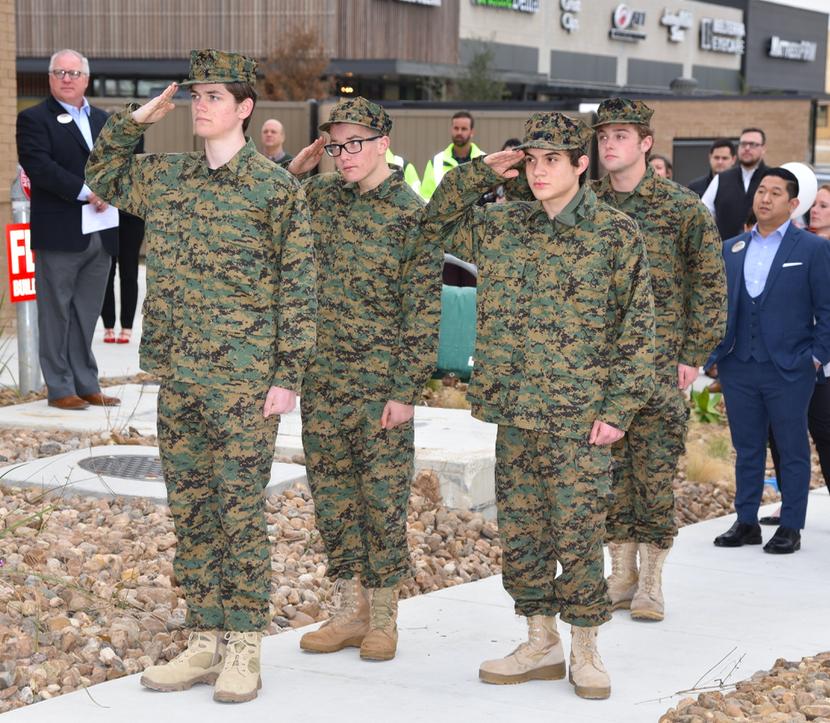 DSHS ROTC Club salute the U.S. Flag.