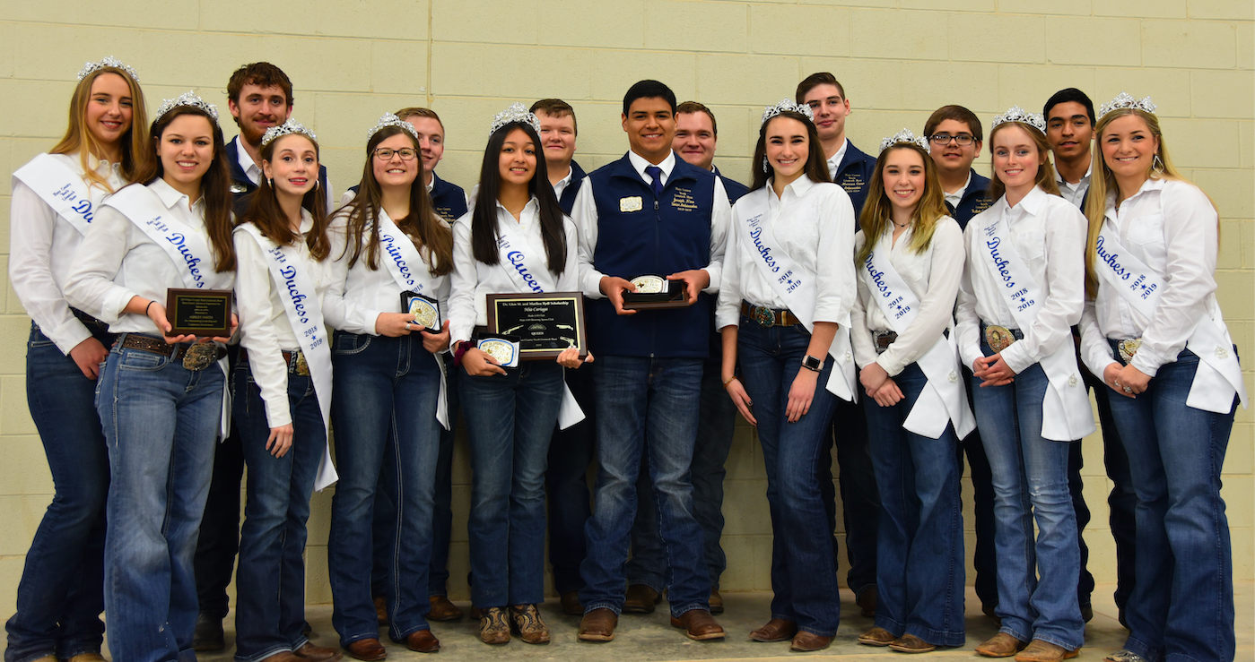 The Hays County Livestock Show 2019 Queen's Court. From left to right, Kaitlyn Baker, Ashley Smith, Marcus Hildebrand, Rebekah McDaniel, Faith Baxter (Princess), Cade Oldham, Mia Cariaga (Queen), Cooper Moore, Joseph Nino (Sr. Ambassador), Jacob Hill, Grace Vasicek, Marcus Cano, Emily Brown, Kaleb Covarrubias, Arielle Wortham, Hayden Lugo, and Konleigh Eben.  Not present:  Ty Dahlstrom.