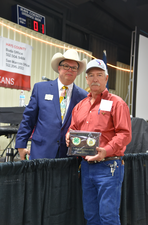 Jeff Dodd, President of the Hays County Livestock Show, presents the Herdiman Award for the Lamb Division to Eddie Ronshansen of Wimberley. CENTURY NEWS PHOTO BY JOHN PACHECO