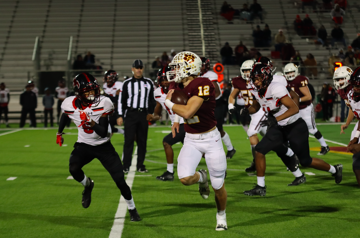 Running Back Curtis Cox runs the ball back against the Manor Mustangs.